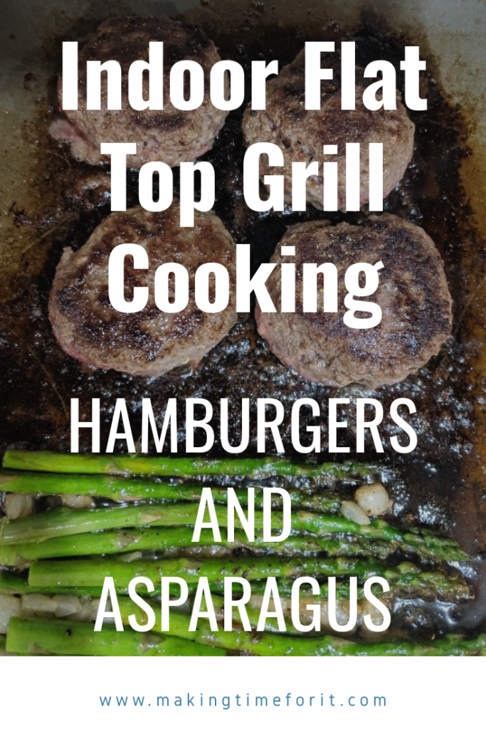 flat top grilling hamburgers and asparagus